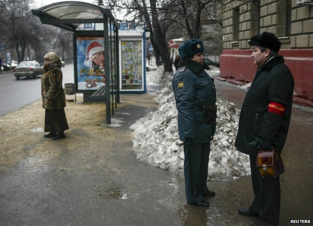 A policewoman speaks to a neighbourhood watch volunteer in Volgograd, 31 December