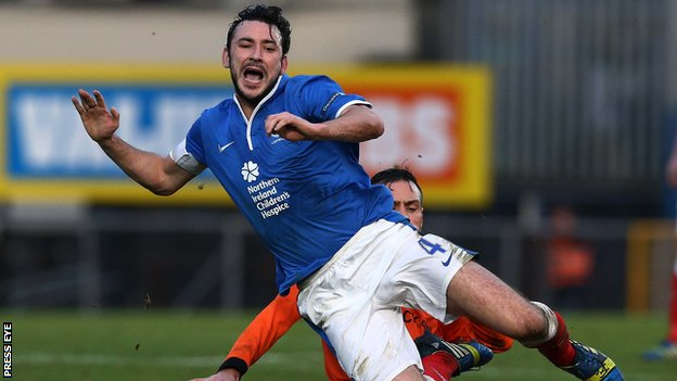 Linfield skipper Michael Gault