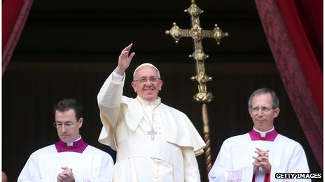 Pope Francis waves to the faithful as he delivers his Christmas Day message