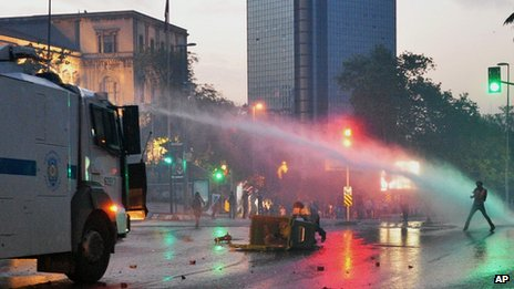 Police use water cannon against protesters in an Istanbul street on 31 May 2013