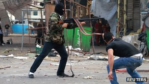Lebanese Sunni gunmen fire a weapon in the northern Lebanese town of Tripoli on 26 May 2013