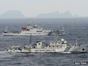 Chinese surveillance ships with the disputed Diaoyu/Senkaku islands in the background on 23 April 2013