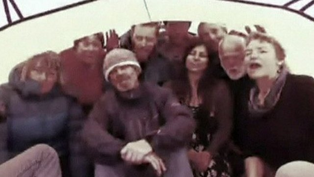 Scientists and tourists trapped aboard the MV Akademik Shokalskiy ship sing a song