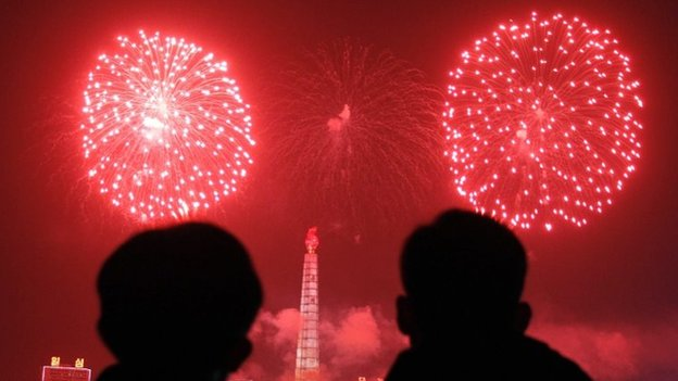 Fireworks explode over Juche Tower and the Taedong River in Pyongyang