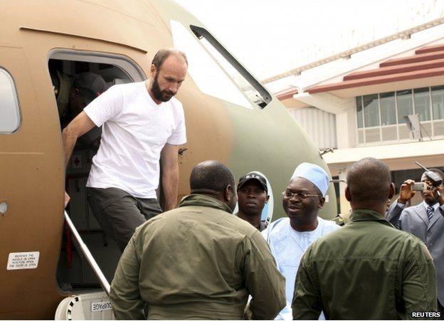 Fr Georges Vandenbeusch disembarking from a plane in Yaounde, Cameroon, 31 December
