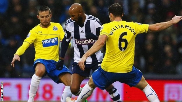 Nicolas Anelka of West Bromwich Albion takes on Michael Williamson (right) and Yohan Cabaye of Newcastle