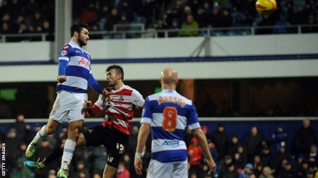 Charlie Austin of Queens Park Rangers scores his team's second goal