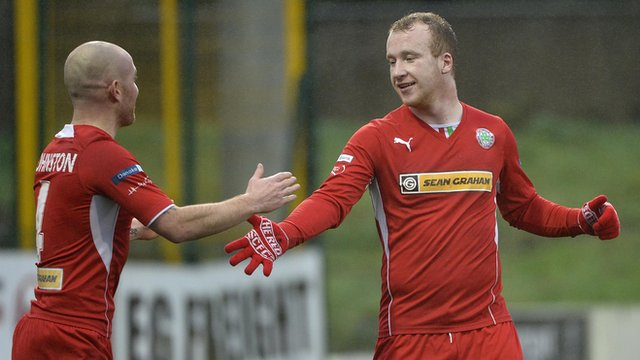 Cliftonville's Barry Johnston celebrates with goalscorer Liam Boyce