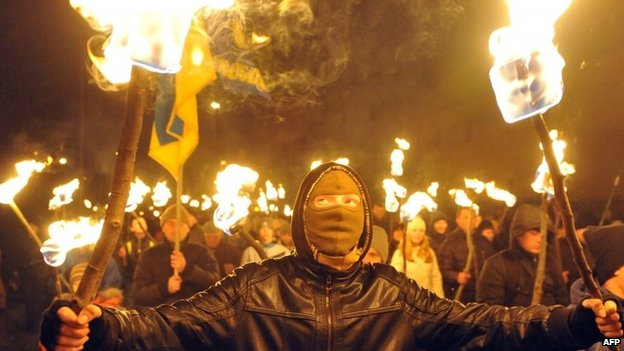 Nationalists hold torches during a march in western Ukrainian city of Lviv