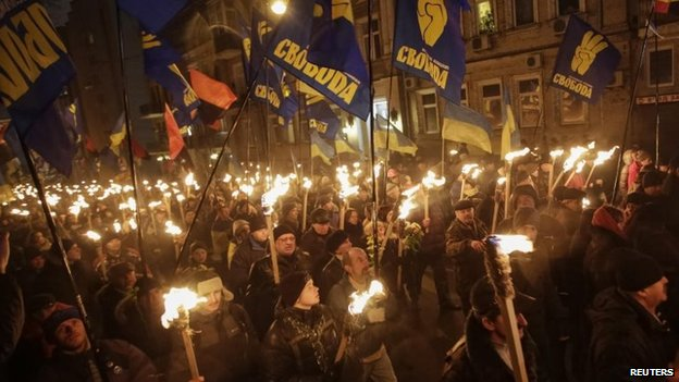 Activists of the Svoboda (Freedom) Ukrainian nationalist party hold torches as they take part in a rally