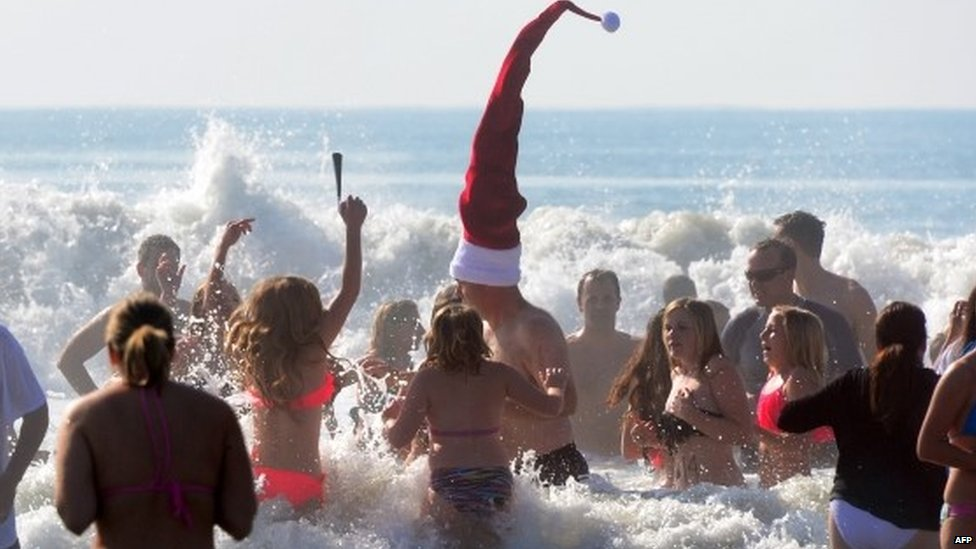 Participants at the annual Pier Plaza Plunge spend their few minutes in the chilly waters of the Pacific Ocean off Huntington Beach, California, for the New Year's Day tradition on January