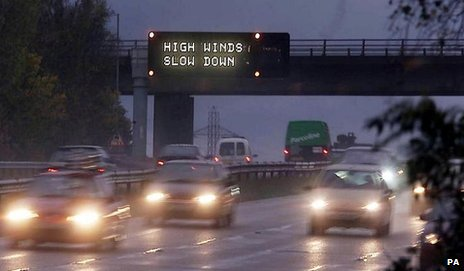 A motorway sign warning of bad weather