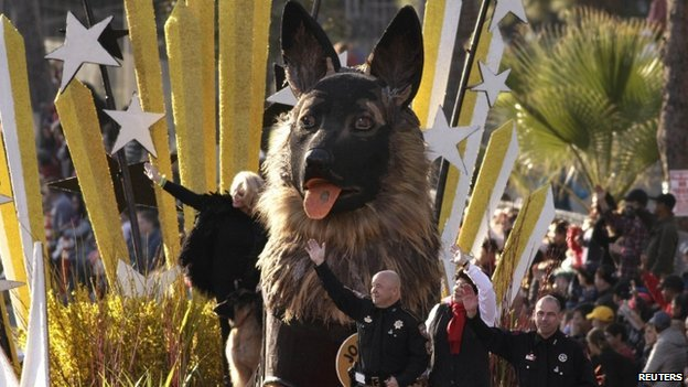 Law enforcement officers ride on the K9s4Cops float at the Rose Parade in Pasadena,  California