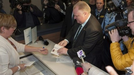Toronto Mayor Rob Ford officially shows his passport to a city clerk on 2 January 2014