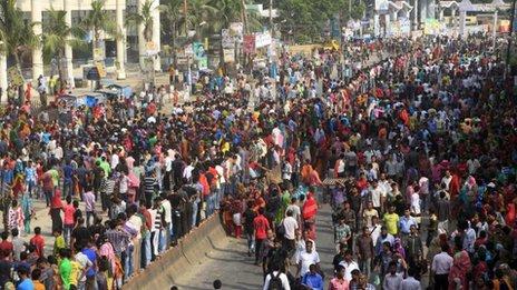 Bangladeshi garment workers block a street during a protest in Gazipur, 40 kilometers (25 miles) north of Dhaka, Bangladesh, Monday, Sept. 23, 2013.