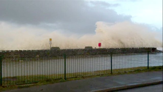 Waves hitting the seafront at Barmouth, Gwynedd