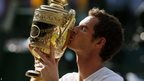 Andy Murray kisses the Wimbledon trophy after becoming the first British man to win the singles title since Fred Perry in 1936
