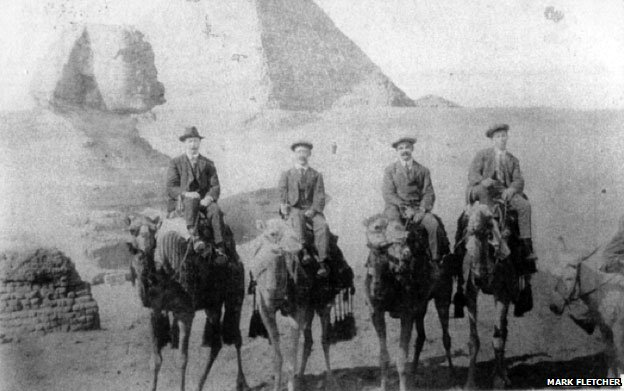The flight crew on Christmas Eve 1913 riding camels