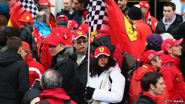 Fans gather outside the Grenoble University Hospital Centre to mark the 45th birthday of former German Formula One driver Michael Schumacher (3 Jan 2014)