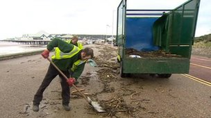 Workmen clearing debris