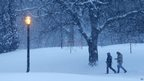 People walking through snow