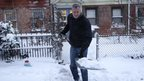 New York City Mayor Bill de Blasio shovels the sidewalk in front of his house in New York 3 January 2014