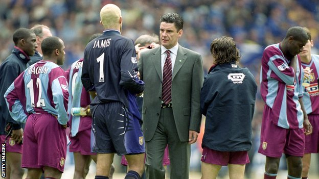 Villa boss John Gregory consoles his team after their FA Cup final defeat by Chelsea at Wembley 14 years ago
