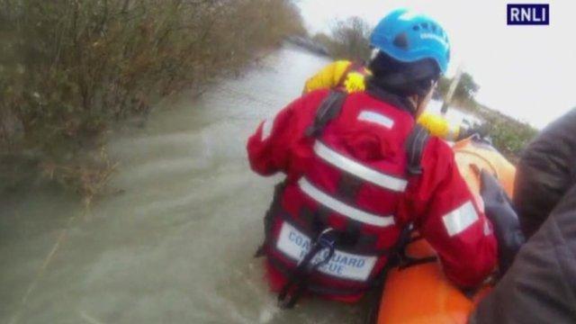 Coastguard stands in waist-deep water