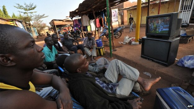 Malian citizens watch the 2013 Africa Cup of Nations football match between Mali and Ghana on a TV set on January 24, 2013 in the capital Bamako