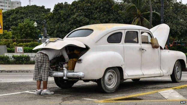Cuban repairs car in Havana, 31 Jan