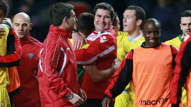 Sheffield United manager Nigel Clough (centre) celebrates after his side's FA Cup win over Aston Villa