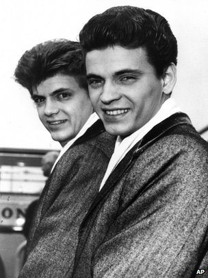 Phil, left, and Don of the Everly Brothers arrive at London Airport from New York to begin their European tour on 1 April 1960 file photo