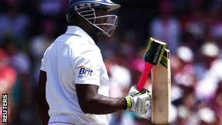 Michael Carberry examines his broken bat at the SCG