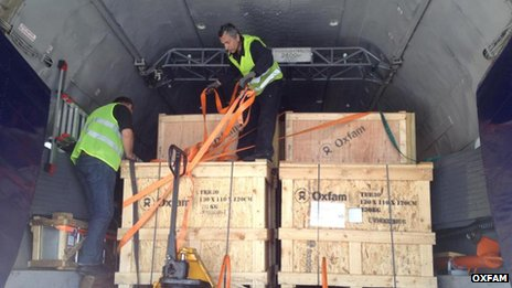 Men unloading Oxfam materials from the aid flight