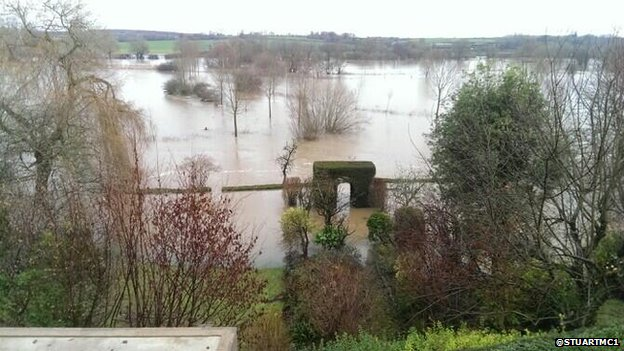 "Stuart McGregor said the river at Crawford Bridge in Spetisbury, Dorset, was not as high as Christmas eve but was ""still rising"""
