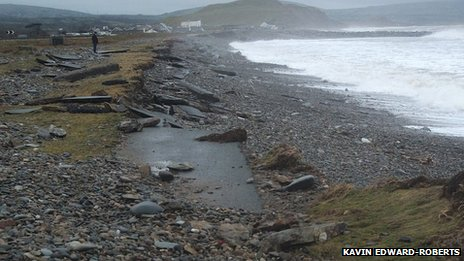 Part of the path washed away at Dinas Dinlle beach near Caernarfon