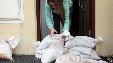 Woman putting out sandbags