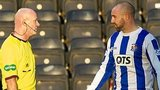 Referee Craig Charleston is questioned by Kris Boyd