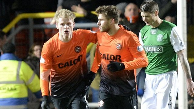 Gary Mackay-Steven congratulates David Goodwillie on pulling a goal back for United