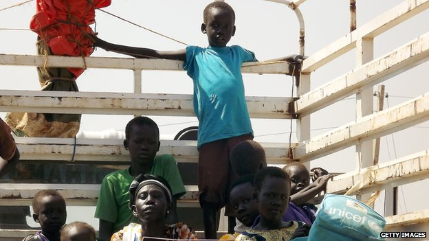South Sudanese citizens from the Jonglei State are pictured on a truck in Juba on January 4, 2014 as they try to leave for Uganda.