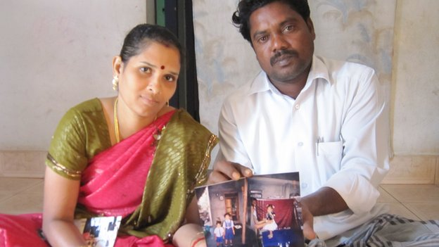 Bhagyalakshmi and her husband Shaktivel with photos of the children they lost in the 2004 tsunami