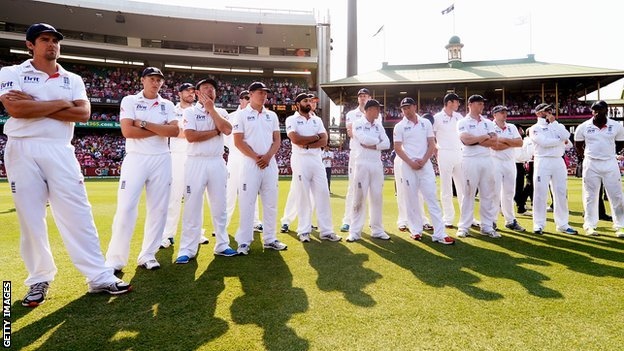 England captain Alastair Cook (left) and his players after defeat in Australia