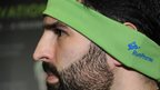 Casey Macioge shows off the RunPhones headband which comes with removable headphones designed to stay put during a work out. The moisture absorbing material is thin enough to allow runners to hear surrounding traffic.