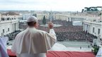 Pope Francis waves from the balcony overlooking St Peter's Square at the Vatican  on 25 December, 2013