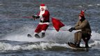Water-skiers celebrate Christmas on the Potomac river in Maryland (24 December 2013)