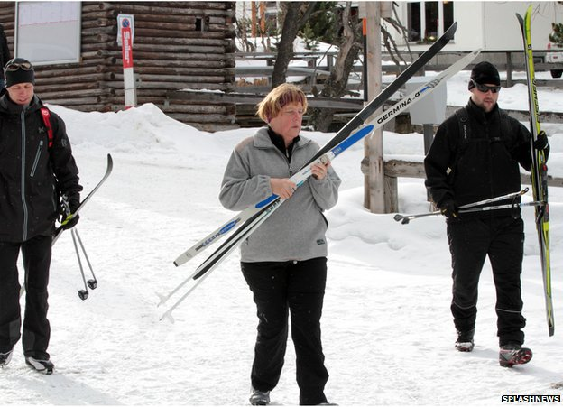German Chancellor Angela Merkel skiing in St Moritz with bodyguards during a Christmas break 22 Dec 13
