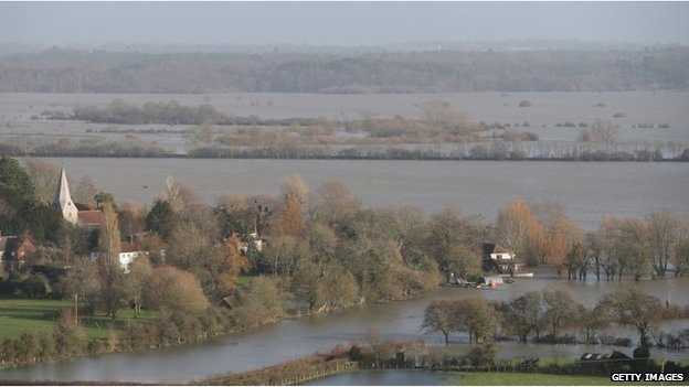 A house in the village of Bury is surrounded by flood water from the River Arun