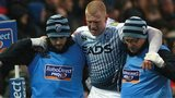 Rhys Patchell is helped off the field by Cardiff Blues medical staff
