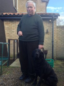 Chris Michaels with Miller the guide dog