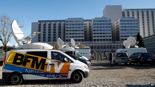 A TV van is parked in front of the Grenoble hospital, French Alps (Jan. 5 , 2014)